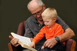 /Files/images/grandfather-grandson-reading-bible.jpg